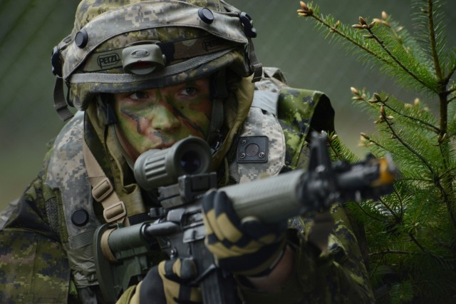 A Soldier assigned to the 39th Canadian Brigade Group watches fellow team members move into advancing positions at Joint Base Lewis-McChord, April 28, 2018, as part of Exercise Cougar Rage 18, April 26-29. Members of the Oregon National Guard's 2nd Batallion, 162nd Infantry Division served as scouts and snipers during the four days of training.