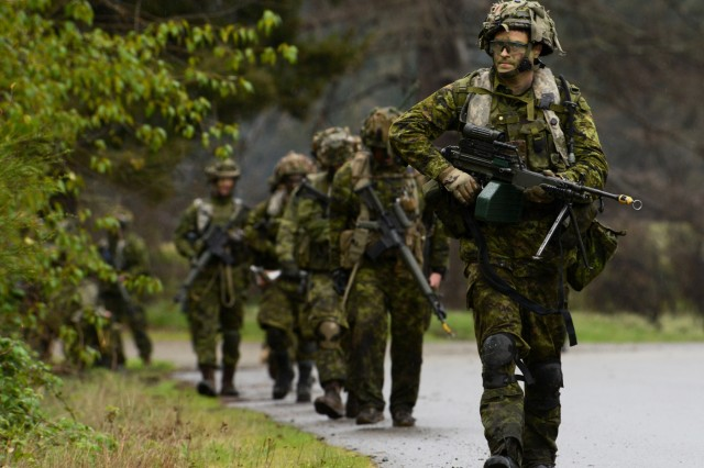 Soldiers assigned to the 39th Canadian Brigade Group proceed along a road march toward the 'Leschi Town' training area at Joint Base Lewis-McChord, Washington, April 28, 2018. Soldiers from the Oregon National Guard and Canada took part in four-days of training as part of Exercise Cougar Rage, April 26-29.