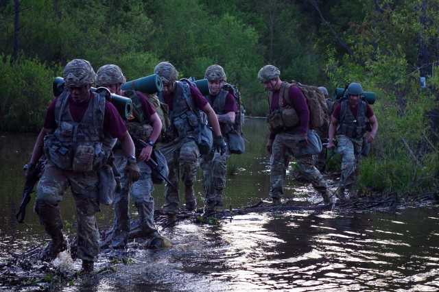 Paratroopers from 1st Battalion, 319th Airborne Field Artillery Regiment wade through a river during the 3rd Brigade Combat Team, 82nd Airborne Division's May Best Squad Competition.