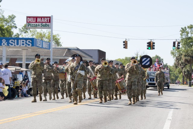 The 3rd Infantry Division marching band, marches down the street during the 2018 Stand Up For America Day Parade held April 28, in Port Wentworth, Ga. Port Wentworth's Stand up for America Day is held every year on the last Saturday in April to honor America's service men and women, past and present. The streets of Port Wentworth are filled with music, arts, crafts, food, and carnival rides. This homegrown celebration of American heritage also includes fireworks that light up the city's night sky. (U.S. Army photo by Staff Sgt. Nathan Berry/released)