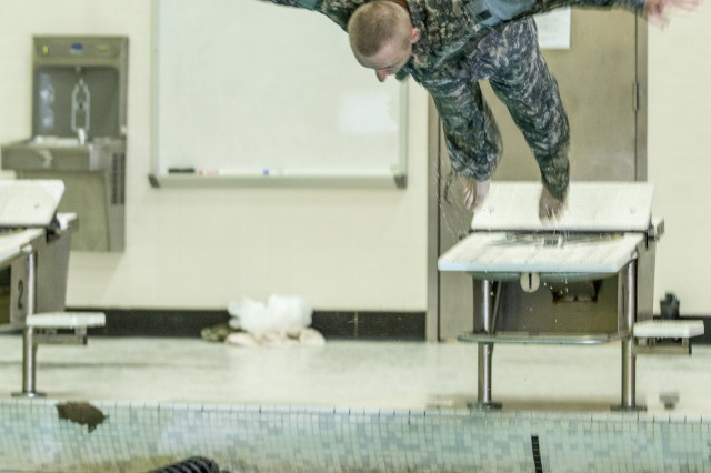 U.S. Army Spc. Ilya Titov, an infantryman assigned to Alpha Company, 1st Battalion, 69th Infantry Regiment, New York Army National Guard (NYARNG), dives for the German Armed Forces Swim Test portion of the state-level NYARNG Best Warrior Competition in Arvin Gym at the United States Military Academy, West Point, N.Y., April 19, 2018. The Best Warrior Competition, held April 18-22, 2018, is an annual event in which junior enlisted Soldiers and non-commissioned officers from various units compete in several events intended to test their military skills and knowledge, as well as their physical fitness and endurance.