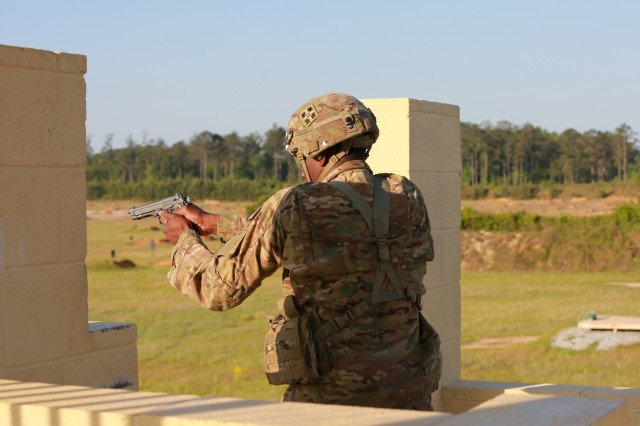 FORT BENNING, Ga. (May 2, 2018) -- A tank crew member fires a 9mm pistol during a stress shoot on the first full day of the Sullivan Cup. After the first full day of competition May 1 at Fort Benning, Georgia, the 2nd Tank Battalion, 2nd Marine Division, from Camp Lejeune, North Carolina, took the lead in the Sullivan Cup, the biennial competition to determine the top four-person tank crew in the world. The 316th Cavalry Brigade hosts the competition to highlight the tank's platform lethality and application of Integrated Weapons Training Strategy. (U.S. Army photo by Markeith Horace, Maneuver Center of Excellence, Fort Benning Public Affairs / RELEASED)