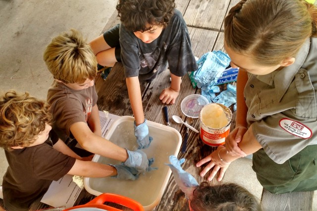 Junior Rangers conduct a science experiment during a program held by the Cape Cod Canal.