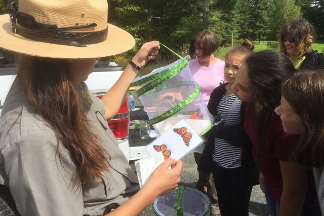 Buffumville Lake/Hodges Village Dam Park Ranger Nicole Giles show students the butterflies they will tag and set free during the Buffumville Lake Pollinator Event, September 9, 2017. Buffumville Lake will be re-energizing their Junior Ranger Program, giving credit to students who attend interpretive events at the dam.