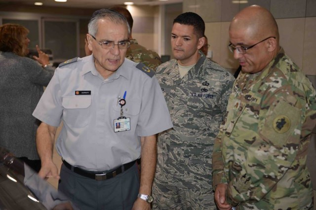 Chilean Army Brig. Gen. Juan Eduardo Durruty Ortuzar (left), Director General of the Chilean Army Military Hospital, speaks with U.S. Army South Maj. Alejandro Bonilla (right), Environmental Science Officer, and U.S. Air Force Command Sgt. Maj. Antonio Araiza, during a visit of the hospital in Santiago, Chile, Apr. 18.