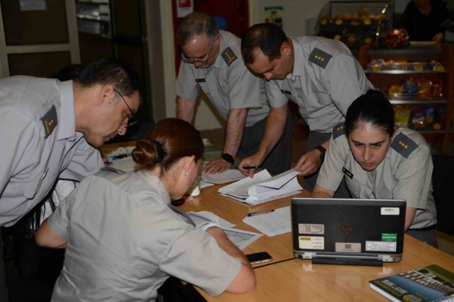 Chilean Army Capt. Javiera Lagos (right), a Veterinary Medicine specialist, and Soldiers from the Chilean Army Veterinary Service review data during a group exercise focusing on a vector born risk assessment pre-deployment scenario, Apr. 17.