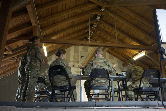 Medical Support Unit -- Europe Soldiers discuss future plans in their work area during the unit's annual training April 25 at Clay Kaserne in Wiesbaden, Germany.