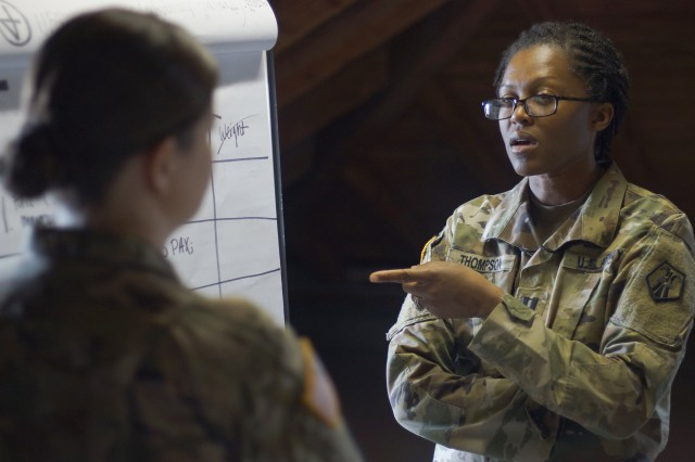Capt. Isis Thompson speaks to Capt.  Amanda Cooper during the Medical Support Unit-Europe's annual training April 25 at Clay Kaserne in Wiesbaden, Germany.