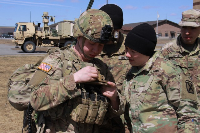 Spc. Joshua Wilson (left) talks with 1st Lt. Megan Walden about the Precision Fires-Dismounted application on the Nett Warrior End User Device at Fort Drum, New York, April 5, 2018.  He is assigned to 3rd Battalion, 6th Field Artillery Regiment, 1st Brigade Combat Team, 10th Mountain Division (LI).