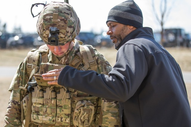 Larry Ladent (right), a new equipment training instructor, teaches Pfc. Austin Thill on the operation of the Precision Fires-Dismounted application at the Mission Training Center at Fort Drum, April 5, 2018. Thill is assigned to 3rd Battalion, 6th Field Artillery Regiment, 1st Brigade Combat Team, 10th Mountain Division (LI).