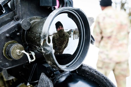 Soldiers with the 82nd Brigade Engineer Battalion, 2nd Armored Brigade Combat Team, 1st Infantry Division, examines a Javelin Weapon Testing System during a multinational cross-training session with U.K. soldiers in Tapa, Estonia, March 9, 2018, as part of a rapid response readiness exercise in support of Atlantic Resolve.