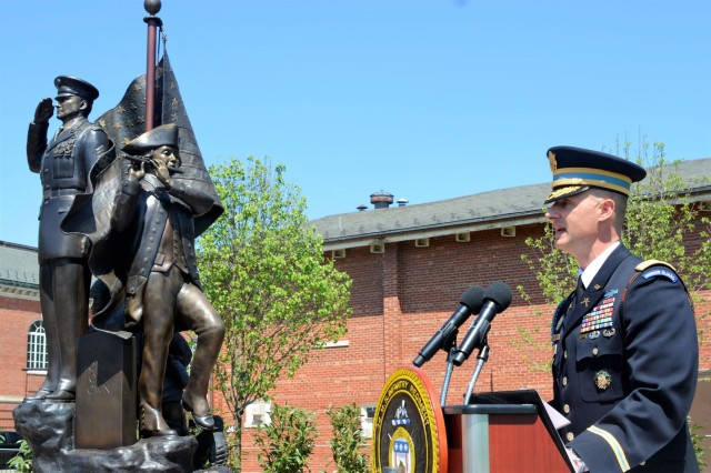 The 81st Regimental Commander Col. Jason Garkey gives remarks May 1 at the unveiling of The Old Guard Monument on Joint Base Myer-Henderson Hall.