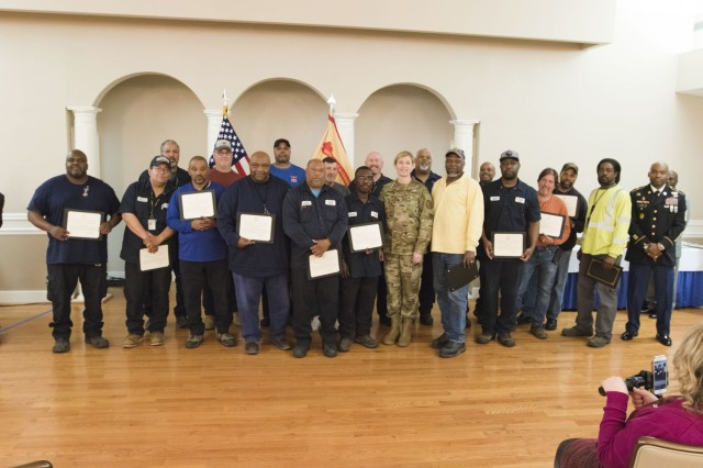 Joint Base Myer Henderson-Hall Command Col. Kimberly A. Peeples poses with members Directorate of Public Works staff. The staff was one of many who received awards during the 2018 second quarter awards ceremony at Spates Community Center April 26.