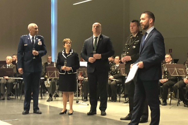 Maj. Gen. Leonard Isabelle, Michigan Air National Guard commander, U.S. Ambassador to Latvia Nancy Pettit, Latvia's Minister of Defense, Raimonds Bergmanis, Lt. Gen. Leonids Kalni��, Latvia's National Armed Forces commander, and event moderator Kaspars Galkins, prepare to toast the 25th Anniversary of the Latvia-Michigan partnership during a special ceremony, April 27, 2018 in Riga, Latvia.