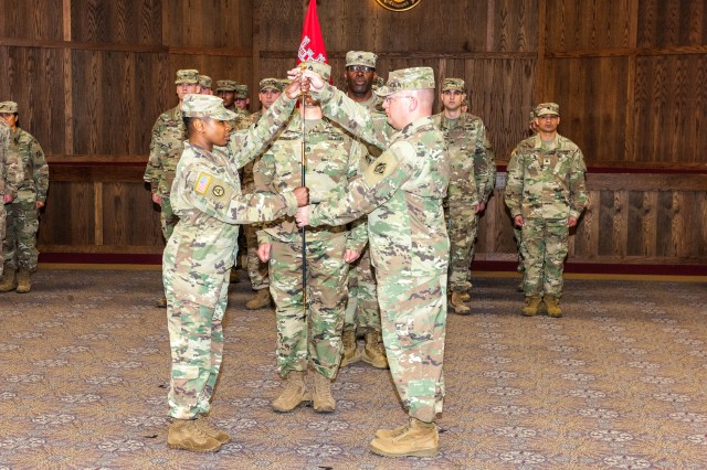 1st Sgt. Barry Newnam II, outgoing PPS first sergeant, hands to noncommissioned officer sword to Command Sgt. Maj. Faith Alexander, 249th Engineer Battalion out of Ft. Belvoir, Va., during a ceremony held Monday.