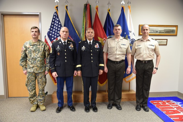 Brig. Gen. Ainars Ozolins, Commander, Zemmessarde; Command Sgt. Maj. Eriks Liflands, Senior Enlisted Leader, Zemmessarde; Lt. Col. Andrejs Zaburdayevs, OIC, JHQ Special Operations Cell; and MG Gregory Vadnais, Adjutant General Michigan National Guard, and guests celebrate the Michigan-Latvian 25 Year State Partnership Program. A special book and movie were presented and a toast via VTC between the two countries celebrated the partnership of the past and the many years to continue.