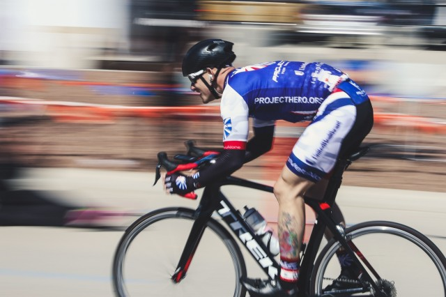 U.S. Army Sgt. First Class James Shields, assigned to the Madigan Army Medical Center- Joint base Lewis-McChord, crosses the finish line at the cycling event during the Army Trials at Fort Bliss, Texas, March 4, 2018. 74 wounded, ill or injured active duty Soldiers and veterans participate in a series of events that are held at Fort Bliss, Texas, Feb. 27, through Mar. 9, 2018, as the Deputy Cheif of Staff, Warrior Care and Transition hosts the 2018 U.S. Army Trials. (U.S. Army photo by Spc. Joseph Friend)(Photo has been modified with sharpening enhancements)