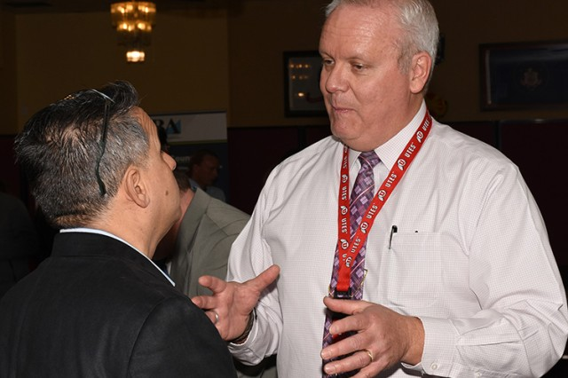180412-A-BB276-009 Small Business Vendor Fair at Dugway Proving Ground, Utah for the public April 12, 2018. Right: Jim Keetch, director of the Mission & Installation Contracting Command (MICC) office on Dugway, speaks with a visitor interested in submitting a bid. The event was sponsored by the Mission and Installation Contracting Command (MICC) office at Dugway, and the regional MICC office that oversees Fort Carson, Colorado; Fort Sill, Oklahoma; and Dugway. Photo by Al Vogel, Dugway Proving Ground Public Affairs