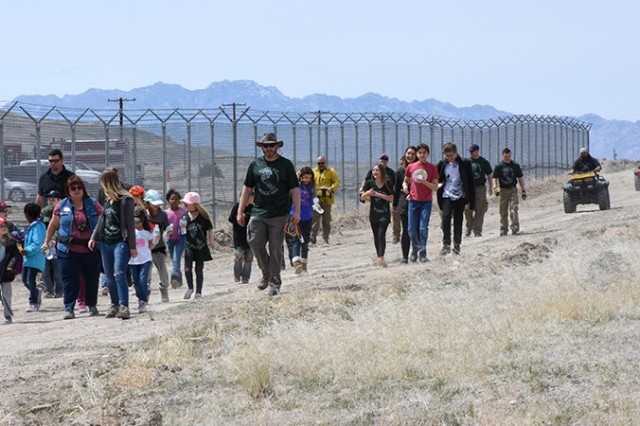 180418-A-BB276-002 It took different people to plant native grasses April 18, 2018 in observance of Earth Day at Dugway Proving Ground, Utah. The native plants were placed along a firebreak north of Gate 2; it is hoped the native grasses will begin to push aside the invasive, non-native Cheatgrass that promotes range fires and doesn't provide food or cover for wild animals. Photo by Al Vogel, Dugway Proving Ground Public Affairs