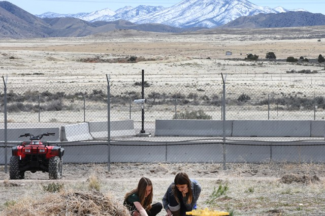 180418-A-BB276-009 Two girls plant native bunchgrasses along a firebreak during the April 18, 2018 observance of Earth Day at Dugway Proving Ground, Utah. Children and adults joined scientists from Dugway's Natural Resource Office, and firefighters. Nearly 400 native plants will eventually be planted along the firebreak, discouraging the growth of invasive Cheatgrass and reducing the chances for range fires to spread. Photo by Al Vogel, Dugway Proving Ground Public Affairs
