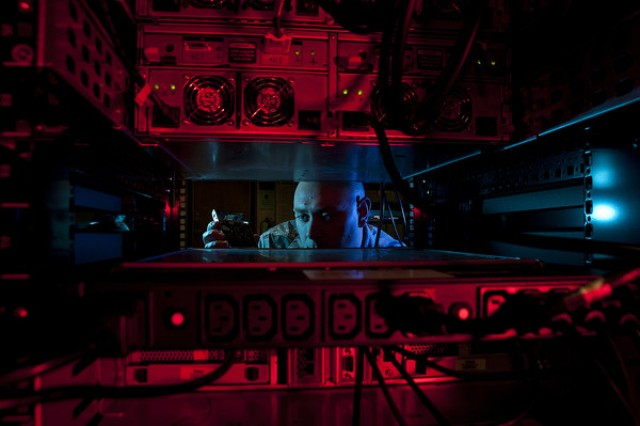 An Air Force technician works with equipment. The DOD announced on May 3, 2018 that U.S. Cyber Command would be elevated to a combatant command.