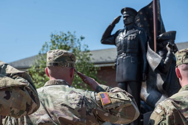 Soldiers from 529th Regimental Support Company, 4th Battalion, 3d U.S. Infantry Regiment (The Old Guard), participate in a reenlistment ceremony for Sgt. Ryan D. Rexon at The Old Guard Monument on Joint Base Myer-Henderson Hall, Va., May 1, 2018. The reenlistment ceremony has special significance as it is the first reenlistment ceremony held at The Old Guard Monument.