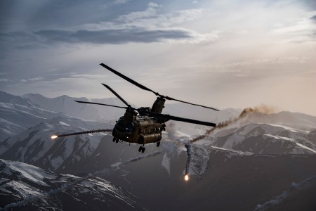 A U.S. Army Task Force Brawler CH-47F Chinook releases flares while conducting a training exercise with a Guardian Angel team assigned to the 83rd Expeditionary Rescue Squadron at Bagram Airfield, Afghanistan, March 26, 2018. The Army crews and Air Force Guardian Angel teams conducted the exercise to build teamwork and procedures as they provide joint personnel recovery capability, aiding in the delivery of decisive air power for U.S. Central Command.