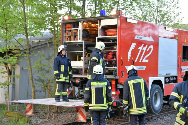 Firefighters from Hochspeyer Volunteer Fire Department back up their state-of-the-art specialty fire vehicle used for large-scale technical rescue operations during an exercise with U.S. Army Garrison Rheinland-Pfalz fire fighters at Kaiserslautern Army Depot, May 3. The fire truck is only one of 14 in Germany and enables firefighters to respond to emergency situations via rail.