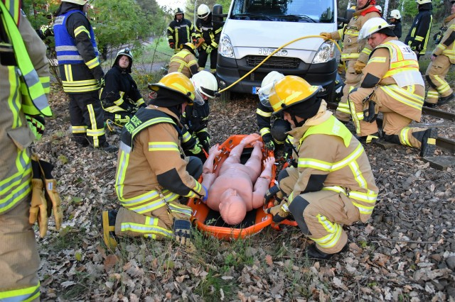 Garrison and Hochspeyer volunteer firefighters prepare a simulated injured person for transport during an exercise at Kaiserslautern Army Depot, May 3. The realistic training gave the firefighters a chance to practice their live-saving skills as well as foster their professional partnership during crises situations.