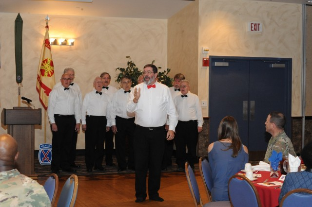 "The Turning Point Chorus Barbershop Quartet performs the National Anthem and ""God Bless America"" at the Commons on May 3 during the National Day of Prayer Luncheon at Fort Drum, New York."