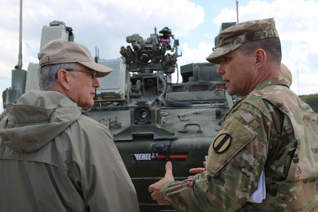 Brig. Gen. Joel Tyler (right), commanding general of the Joint Modernization Command, explains capabilities to Hon. Dr. Bruce Jette, assistant secretary of the Army - Acquisition, Logistics and Technology, Hohenfels, Germany, April 26, 2018. Various military and civilian officials came to Hohenfels to see how the Joint Warfighting Assessment (JWA) helps the Army evaluate emerging concepts, integrate new technologies, and promote interoperability within the Army, with the other services, U.S. allies, and partners.
