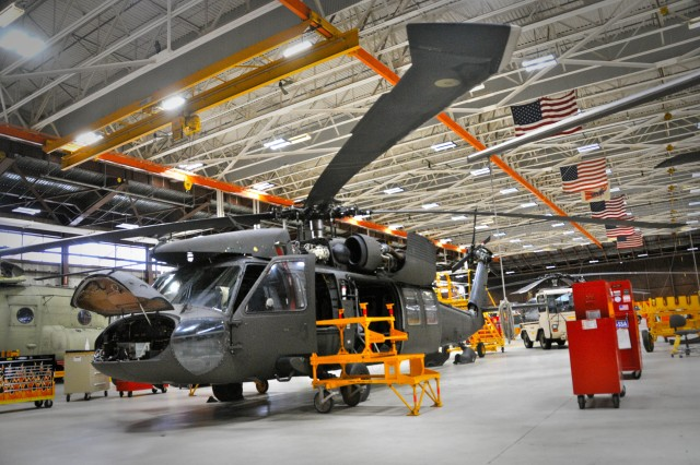One of the 28th Expeditionary Combat Aviation Brigade's UH-60 Black Hawk helicopters in for a routine maintenance check in the flight facility at Muir Army Airfield February 25, 2018. Making sure that current equipment is ready for any fight, as well as prepositioning weapons and equipment around the world, is a key priority for Army readiness.
