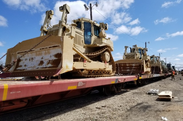 Equipment from the Missouri Army National Guard's 220th Engineer Company is loaded upon trains at the BNSF Railway yard in Springfield, Missouri.