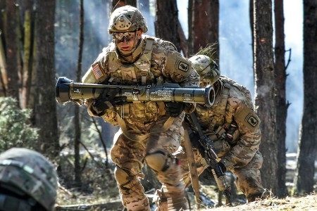 Paratroopers with 503rd Infantry Regiment, 173rd Airborne Brigade, carries a AT-4 training grenade launcher during a platoon level live-fire exercise at the 7th Army Training Command's Grafenwoehr Training Area, Germany, March 21, 2018.