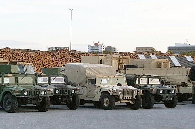 Shown are vehicles that were off-loaded from the Ocean Jazz vessel at the port of Gladstone, Australia. (Photo by Maj. Phil Castillo, 402nd Army Field Support Brigade)
