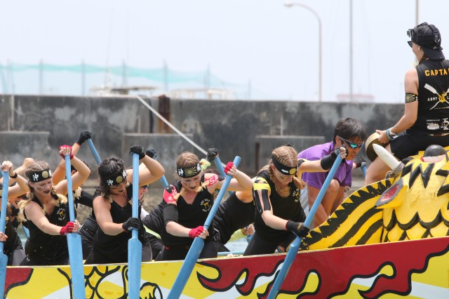 "Dragon Boat Racing is held during Japan's ""Golden Week,"" which begins at the end of April and is celebrated throughout Japan including the island of Okinawa. The ""Army Ladies"" Team whose motto is ''One Boat, One Beat,"" tied for first place and can be seen here preparing for the race to begin."