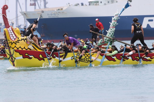 "Dragon Boat Racing is held during Japan's ""Golden Week,"" which begins at the end of April and is celebrated throughout Japan including the island of Okinawa. The ""Army Ladies"" Team who tied for first place approach the finish line."