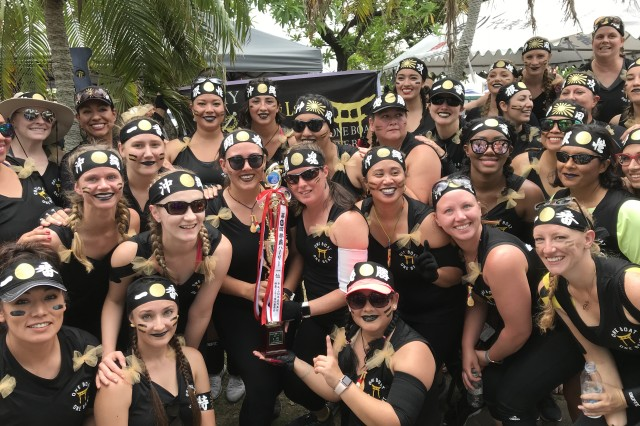 "Dragon Boat Racing is held during Japan's ""Golden Week,"" which begins at the end of April and is celebrated throughout Japan including the island of Okinawa. The ""Army Ladies"" Team display their winning trophy."
