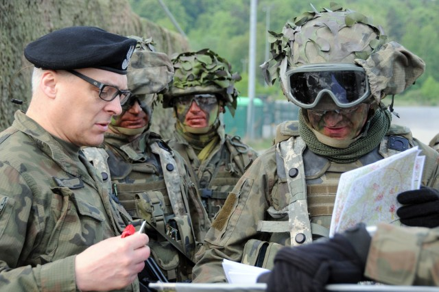 Polish Army Col. Krzysztof Kuba, 12th Mechanized Division chief of staff (left), briefs Maj. Gen. Rajmund T. Andrzejczak, 12th Mech. Div.'s commander (right), prior to a mission in the Hohenfels Training Area, Hohenfels, Germany, during Combined Resolve X May 4, 2018. Combined Resolve X includes approximately 3,700 participants from 13 nations at the 7th Army Training Command's Grafenwoehr and Hohenfels Training Area, April 9 to May 12, 2018. Combined Resolve is a U.S. Army Europe-directed multinational exercise designed to give the Army's regionally allocated combat brigades to Europe a combat training center rotation with a joint, multinational environment.
