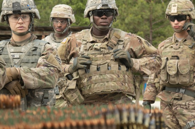 Competitors of the 3rd Infantry Division Best Warrior Competition line up to receive ammunition for the M249 squad automatic weapon and M240B general-purpose machine gun qualification event May 3, 2018, at Fort Stewart, Ga. The three-day competition consisted of events that measured each competitor's physical and mental toughness, as well as their technical and tactical proficiency. The winners of the competition will represent the division at the XVIII Airborne Corps Best Warrior Competition in June. (U.S. Army photo by Sgt. Arjenis Nunez/Released)