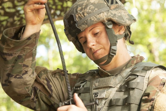Cpl. Janelle Travis, a combat medic assigned to 2nd Combined Arms Battalion, 69th Armor Regiment, 2nd Armored Brigade Combat Team, 3rd Infantry Division, reassembles an M249 squad automatic weapon while being timed during the 3rd ID's Best Warrior Competition, May 3, 2018, at Fort Stewart, Ga. The three-day competition consisted of events that measured each competitor's physical and mental toughness, as well as their technical and tactical proficiency. The winners of the competition will represent the division at the XVIII Airborne Corps Best Warrior Competition in June. (U.S. Army photo by Sgt. Arjenis Nunez/Released)