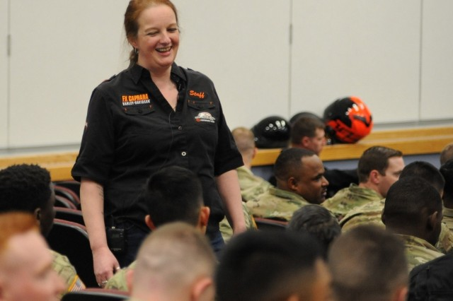 Dawn Fontaine, manager and events coordinator at a local motorcycle dealership, speaks with 10th Mountain Division (LI) Soldiers during Motorcycle Safety Day on May 7 at Fort Drum, New York. Roughly 300 Soldiers are licensed motorcyclists on post, and May is typically the month when motorcycles are retrieved from winter storages and can be seen back on the roads.