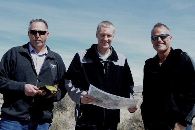 Dugway's three mapmakers: Jared Mathis, GIS Analyst with the Environment Technology Office, Jason Raff, a geographer with Environmental Programs Division and Peter Hansen, GIS analyst, Environmental Technology Office discuss upcoming testing on the range south of West Desert Test Center. Photo by Bonnie A. Robinson, Dugway Public Affairs