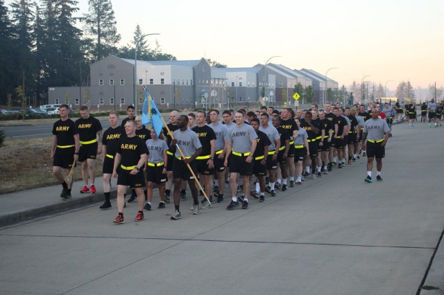 Capt. Bryan Nesbitt (front), the intelligence officer for 5th Battalion, 20th Infantry Regiment, leads his company before a battalion run in August of 2016. Nesbitt was recently selected to be awarded the  Lt. Gen. Sidney T. Weinstein Award for military intelligence excellence.