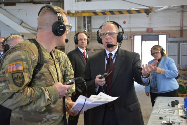 Lt. Col. Joseph Novak, left, listening to a question from Assistant Secretary of the Army Bruce Jette, center, about the product improvements for the Paladin howitzer.  Novak is with the Program Executive Office for Ground Combat Systems.