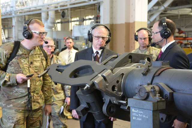 Army Benet Laboratories' Nathaniel Klein, right, briefing Lt. Col. Joseph Novak, left, and Assistant Secretary of the Army Bruce Jette, center, about the product improvements for cannon systems.  Novak is with the Program Executive Office for Ground Combat Systems.