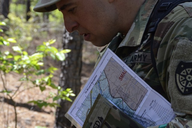 Capt. Edwin Seda with 503 Cyber Protection Team, Army Cyber Protection Brigade, uses a compass to determine the route to his next testing point during warrior skills testing at the CPB Cyber Stakes exercise at Fort Gordon, Ga., May 4, 2018. Cyber Stakes, the brigade's flagship biannual training event, provides CPB Soldiers and civilian employees with three days of instruction, collaboration and evaluation of core cyber skills, followed by two days of training and testing on basic Army warrior tasks for brigade troops.