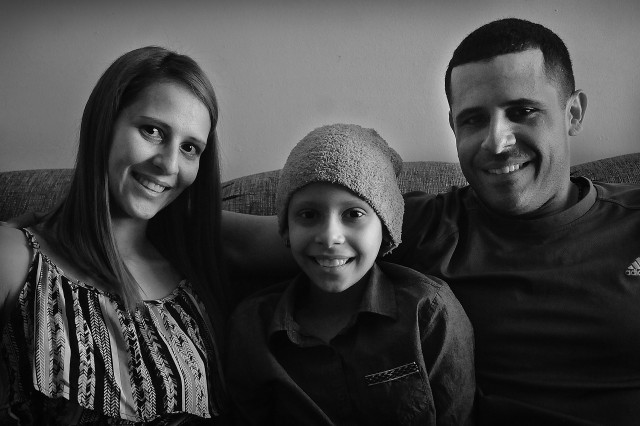 Pfc. Neftali Rios, with his wife, Jennifer and 9-year-old daughter Navila, are native Puerto Ricans who now call the mainland their home. Their daughter fell sick roughly three weeks after the reservist arrived Sept. 13 to attend the Ordnance School for training as a wheeled vehicle.  She was later diagnosed with cancer following surgery.  Neftali went back to Puerto Rico on emergency leave to care for his family, then brought them to the mainland to continue Navila's treatment and resume his training. He was later allowed to transfer to active duty status to continue his daughter's treatment.  He said his chain of command and others were responsible for his good fortune.  He is now assigned to Joint Base Langley-Eustis.