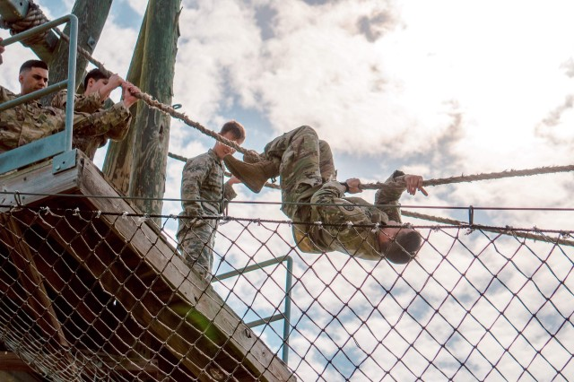 Sgt. Cesar Aguirre navigates the obstacle course on Camp Bullis, Texas, on March 2018, with Soldiers from Brooke Army Medical Center.
