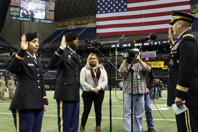 Maj. Gen. Chris Hughes administers the officer oath to cadets during a commissioning ceremony held during the Army All-American Bowl in San Antonio, Texas, Jan. 7, 2017. (Photo by Michael Maddox | Cadet Command Public Affairs)